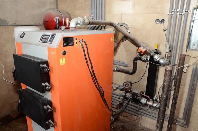 Двухконтурный котел на твердом топливе длительного горения
